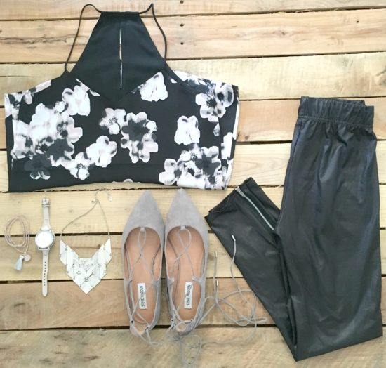 black and grey floral top with leather leggings