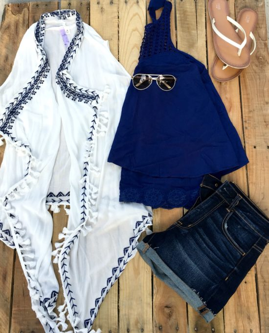 white vest with tassels and blue details