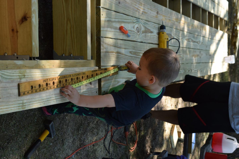 little boy building deck